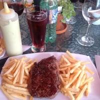 Photo taken at La Carreta Grill by Sergio J. on 8/15/2012