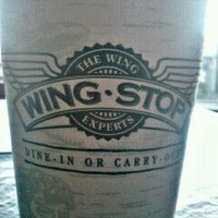 Photo taken at Wingstop by Guillermo P. on 12/14/2011