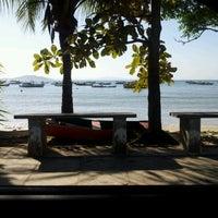 Photo taken at Praia Alegre by E. Gebara on 10/28/2011