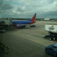 Photo taken at Gate 47 by Jacob C. on 11/7/2011