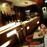 Photo taken at Krunch Pizza Bar by Joshua N. on 11/14/2011