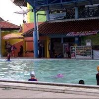 Photo taken at Kolam Renang Tirta Sari by Akhmad Y. on 2/11/2012
