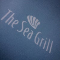 Photo taken at The Sea Grill by Ahmed S. on 7/31/2012