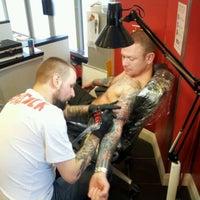Photo taken at RedINC Tattoo & Body Piercing by Elliot B. on 1/16/2012