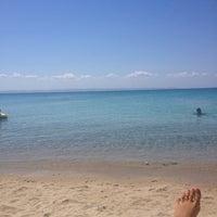Photo taken at Koviou Beach by Isabelle D. on 8/30/2012