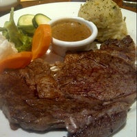 Photo taken at Outback Steakhouse by Nuruli K. on 8/8/2012