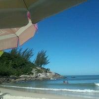 Photo taken at Praia da Ferrugem by Natashe P. on 3/10/2012