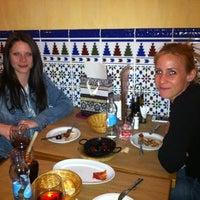 Photo taken at Pata Negra Tapas Bar by Noemi K. on 4/3/2012