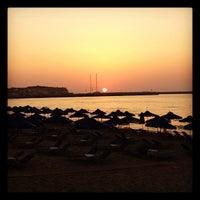 Photo taken at Rethymno Beach by Lynn G. on 6/15/2012