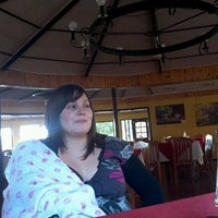 Photo taken at Los Pimientos De Auco Restaurant by Carlos E. on 7/26/2012