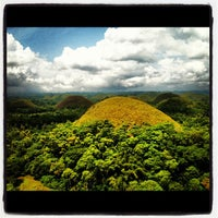 Photo taken at The Chocolate Hills by AJ G. on 5/31/2012
