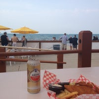 Photo taken at Oak Street Beach Food + Drink by Brian F. on 5/26/2012