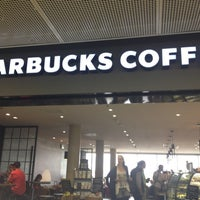 Photo taken at Starbucks by R T. on 7/16/2012