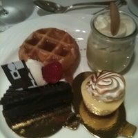 Photo taken at The Café by Sara K. on 7/1/2012