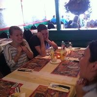 Photo taken at Pizzaria Pavarotti by Patricia V. on 7/21/2012