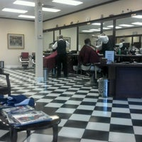 Photo taken at Gino's Classic Barber Shoppe by Martin J. on 4/18/2012