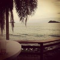 Photo taken at Praia de Juquehy by Andrei B. on 5/12/2012