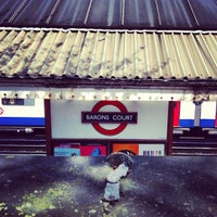 Photo taken at Barons Court London Underground Station by Ming Y. on 4/14/2012