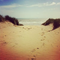 Photo taken at Camber Sands Beach by Jam N. on 8/2/2012