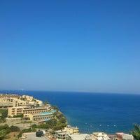 Photo taken at Blue Bay Resort & Spa Hotel by Максим Н. on 8/23/2012