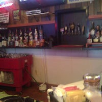Photo taken at Bison's Bar and Grill by Chris N. on 9/19/2011