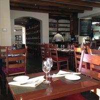 Photo taken at Donato Enoteca Restaurant by Gonzalo C. on 3/3/2012