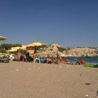 Photo taken at Kolymbia Beach by Tosiro O. on 8/22/2012