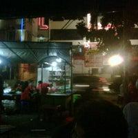 Photo taken at Angkringan Nasi Kucing Mas Jojo by Abra K. on 12/5/2011