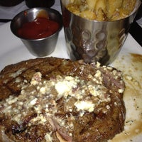 Photo taken at Stoney River Legendary Steaks by ralph a. on 1/8/2012