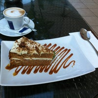 Photo taken at Smallworld Cafe by Yulia A. on 6/16/2012