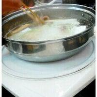 Photo taken at Shinyuu Shabu Shabu & Okonomiyaki by pitch★ p. on 12/23/2011