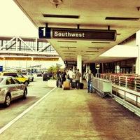 Photo taken at Terminal 1 by Jen Pollack B. on 9/23/2011