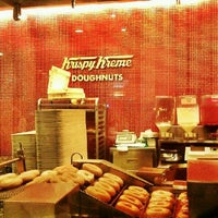 Photo taken at Krispy Kreme by athena f. on 9/1/2012