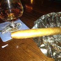Photo taken at Dos Jefes Uptown Cigar Bar by Waymon M. on 5/7/2012