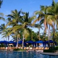 Photo taken at Wyndham Grand Rio Mar Beach Resort & Spa by Byron C. on 10/15/2011