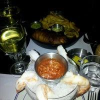 Photo taken at St. Elmo's  Seaside Brasserie by Rachel A. on 1/8/2012