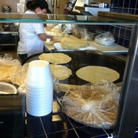 Photo taken at Cafe Rio Mexican Grill by Tom B. on 2/1/2012