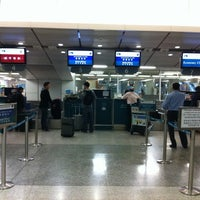 Photo taken at MTR Kowloon Station 九龍站 by Pilar M. on 2/24/2012