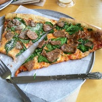 Photo taken at Fellini's Pizza by Mardrequs H. on 5/2/2012