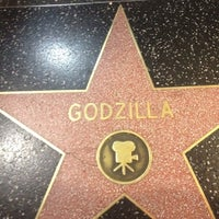 Photo taken at Godzilla's Star, Hollywood Walk of Fame by Ivan N. on 8/24/2012