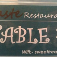 Photo taken at Taste Restaurant by Andrew J. on 10/3/2011