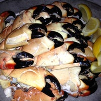 Photo taken at Joe's Stone Crab by Andrew on 3/13/2012