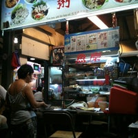 Photo taken at Chomp Chomp Food Centre by Francis L. on 12/24/2010
