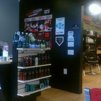 Photo taken at Sport Clips Haircuts of Camino Village Plaza by Frank D. on 5/4/2012