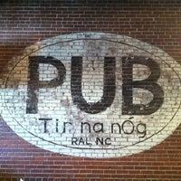 Photo taken at Tír na nÓg Irish Pub by Chris U. on 3/19/2011
