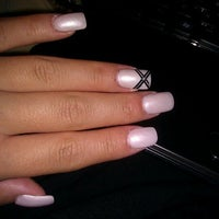 Photo taken at Fancy Nails & Spa by Nina F. on 11/3/2011
