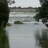 Photo taken at White Rock Lake Spillway by Brittney S. on 10/9/2011