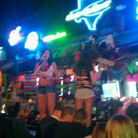 Photo taken at Coyote Ugly Saloon - San Antonio by Monica C. on 1/14/2012