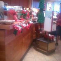Photo taken at Starbucks by Chrisi C. on 12/21/2011