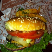 Photo taken at Red Robin Gourmet Burgers by Elliot P. on 12/17/2011